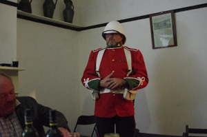 A sidecar soldier in full english regalia